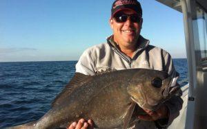 man with fish narooma